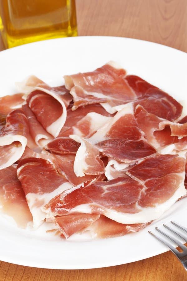 Download Rebanadas de jamón español imagen de archivo. Imagen de carne - 7284081