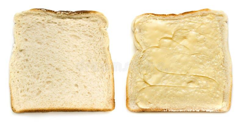 Rebanadas de opinión superior aislada del pan blanco untadas con mantequilla y de Unbuttered imagen de archivo