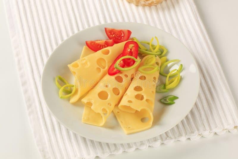 Rebanadas de queso suizo imagenes de archivo