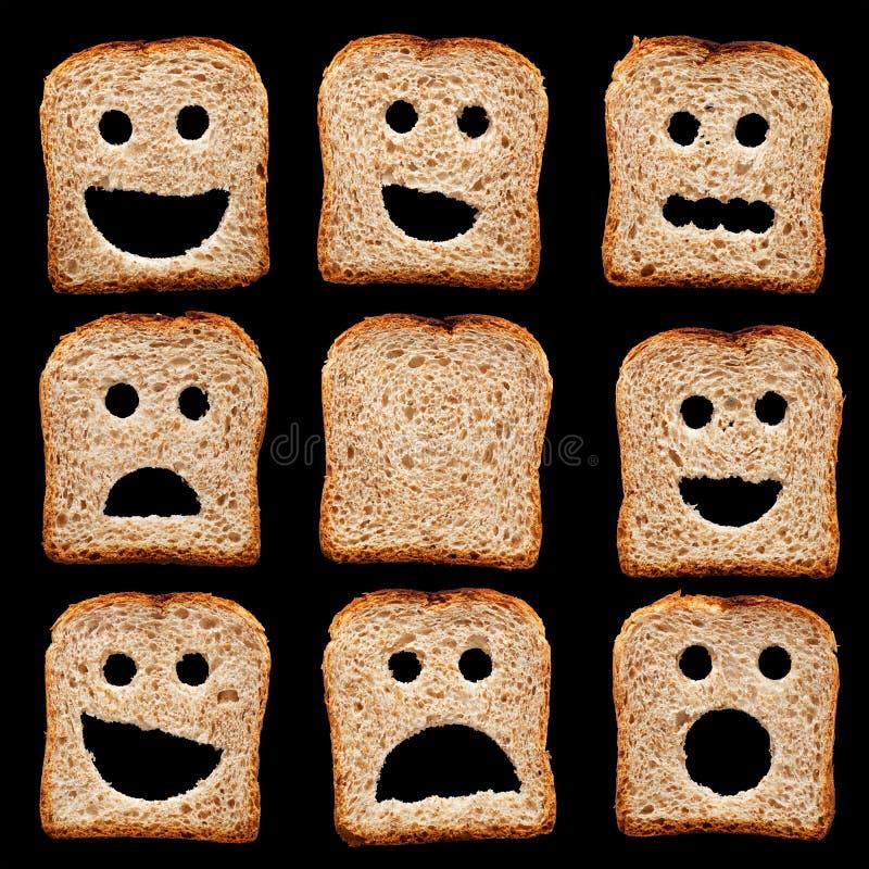 Rebanadas del pan con expresiones de la cara imágenes de archivo libres de regalías