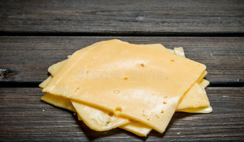 Rebanadas finas de queso foto de archivo libre de regalías