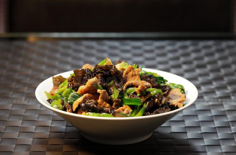 Rebanadas fritas comida-hongo chino del cerdo foto de archivo libre de regalías