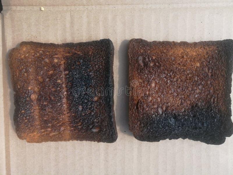 Rebanadas quemadas del pan de la tostada Pan chamuscado fotografía de archivo libre de regalías