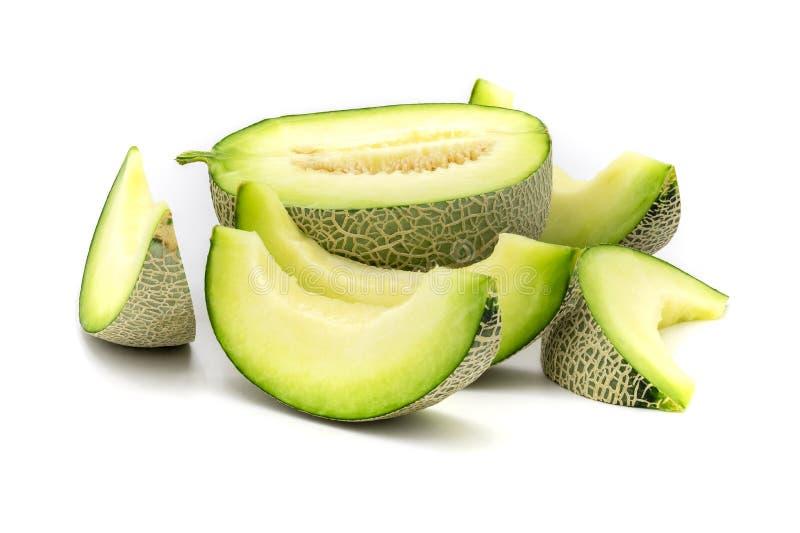 Rebanadas verdes del melón aisladas en el fondo blanco fotografía de archivo libre de regalías