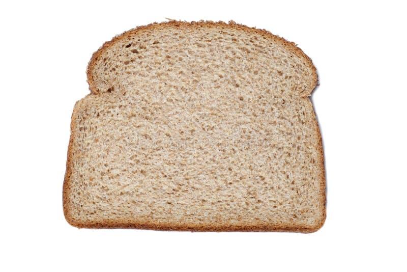 Rebanado del pan del trigo integral foto de archivo libre de regalías