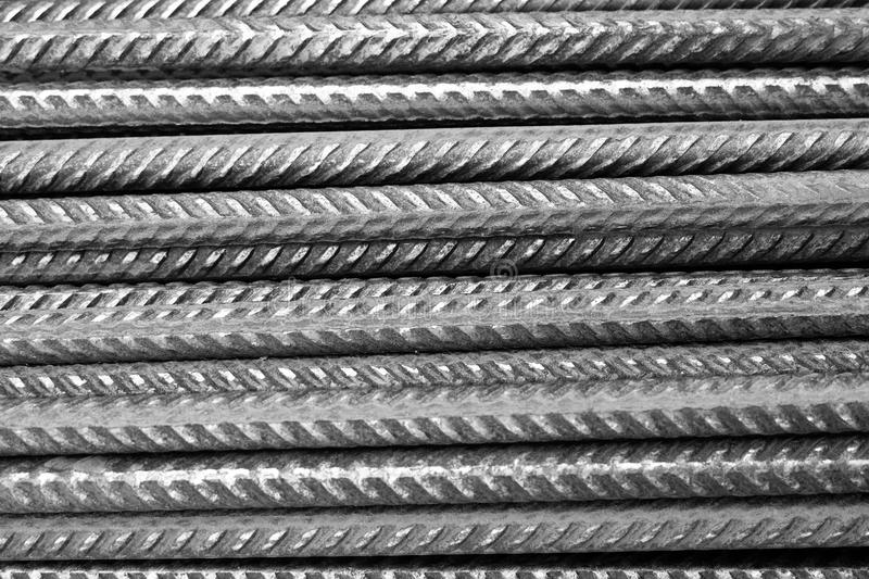 Rebar - black and white - closeup of horizontally stacked steel division reinforcement bars royalty free stock photos