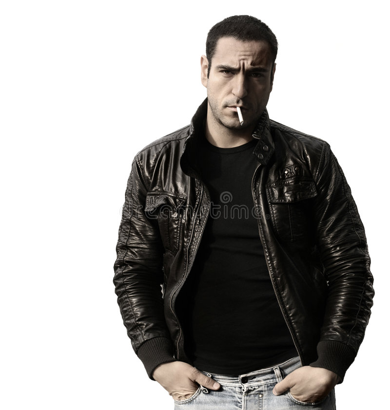 Rebel. Portrait of a rebel type guy in classic leather jacket with cigarette in mouth against white background