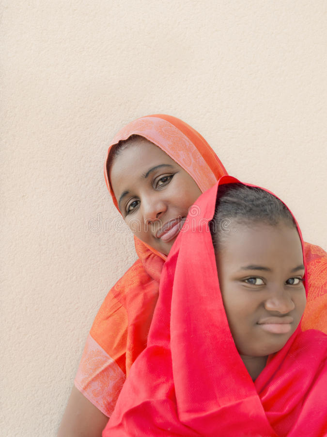 Rebel preteen in the arms of her mother royalty free stock photos