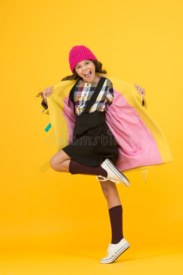 Rebel teen girl. Madcap concept. Teen age. Girl adorable stylish modern teenager. Cool schoolgirl. Have fun charismatic. Girl on yellow background. Teen spirit royalty free stock image