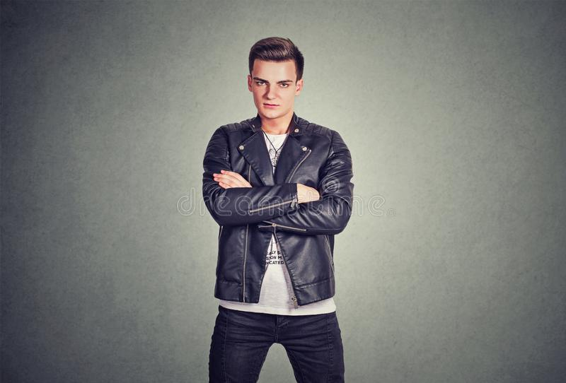 Rebel trendy man in leather jacket stock photography
