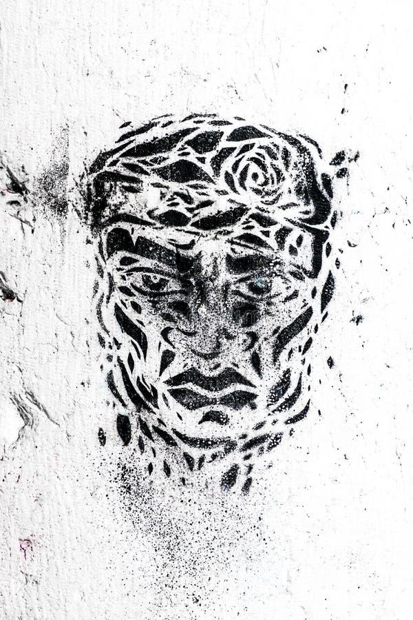 Rebelion смотрит на на стене стоковые изображения