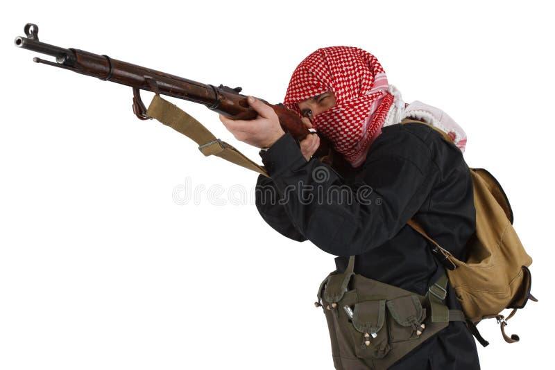 Rebellenlegermilitair in zwarte eenvormig met geweer royalty-vrije stock afbeeldingen