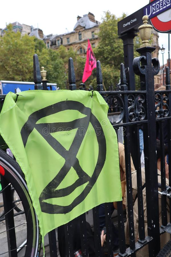 Rebellion Extinction flag at the Rebellion Extinction protest in Trafalgar Square London. royalty free stock photo