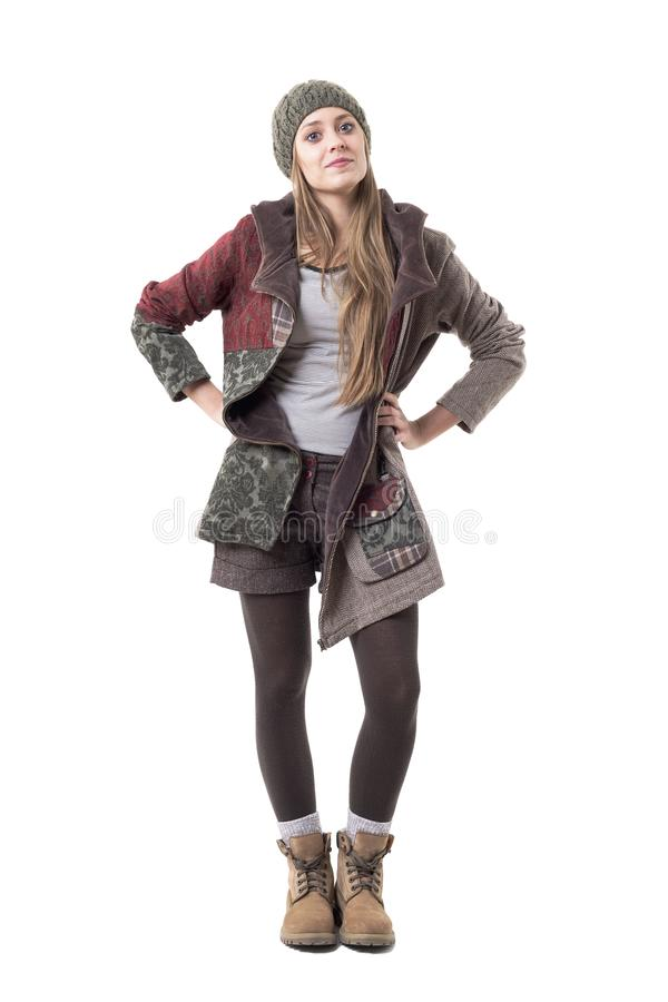 Rebellious young stylish hipster girl with attitude in winter clothes. royalty free stock images