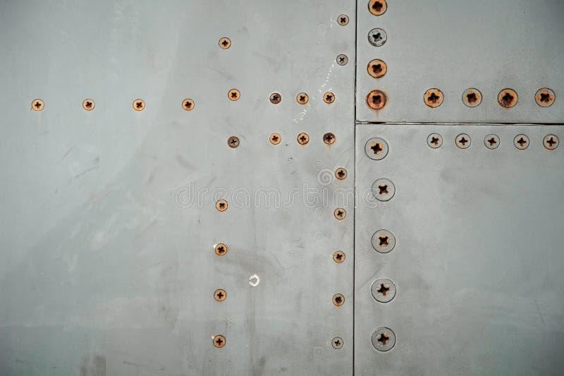 Rebites do avião da oxidação como o fundo fotografia de stock royalty free