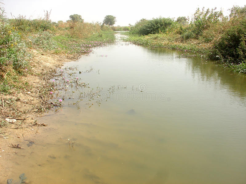 Receding River. A receding river as used by farmers in irrigational farming stock image