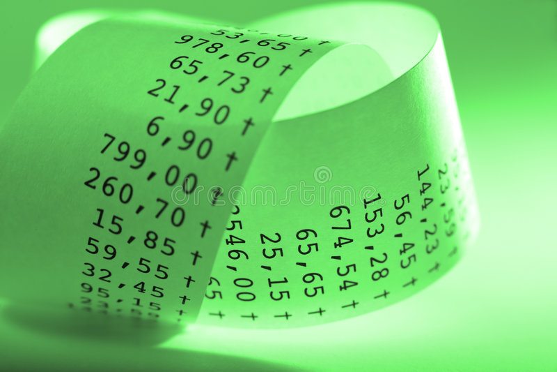 Receipt. Macro of folded receit paper. Shallow DOF. Green tone royalty free stock photos