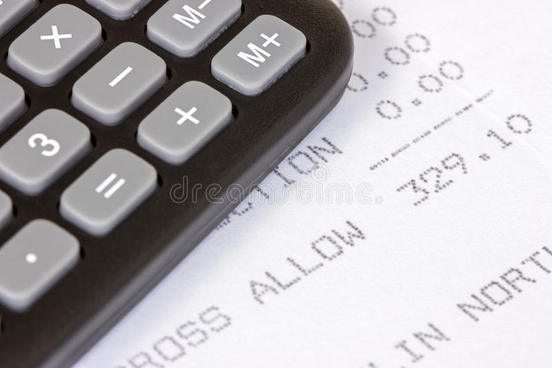 Receipt of allowance. Black calculator with the printed receipt of allowance stock photos