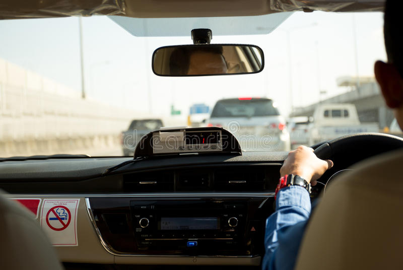 Receipt printer in taxi with taxi driver. On motor way royalty free stock image