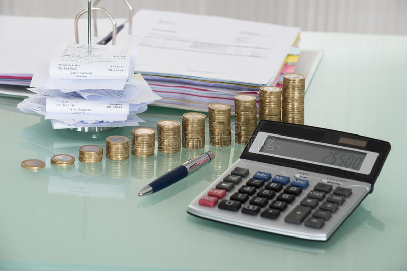 Receipts With Calculator And Money On Desk stock photos