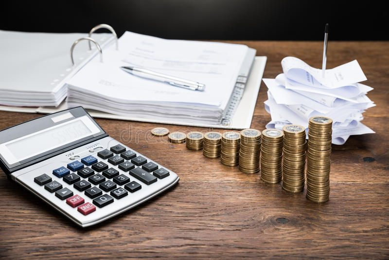 Receipts With Calculator And Money stock photography