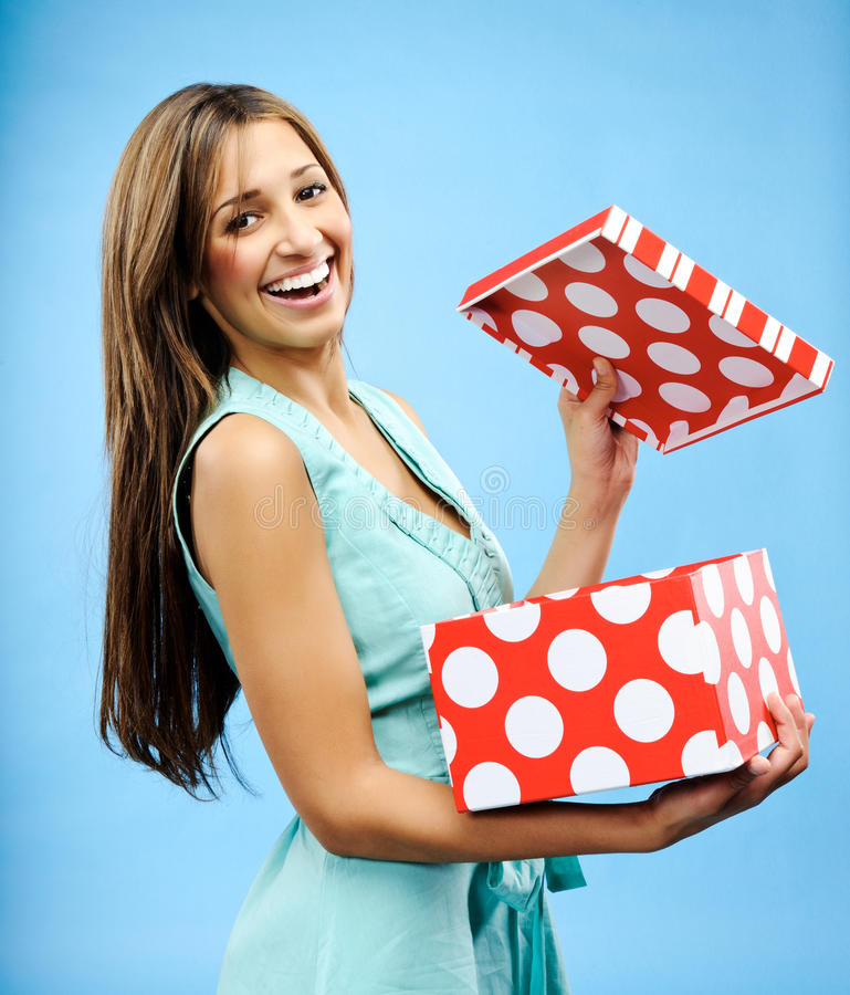 Receive a present. Pretty woman is happy to receive a gift for Christmas royalty free stock photos