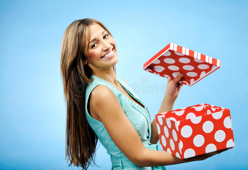 Receive a present. Pretty woman is happy to receive a gift for Christmas stock photo
