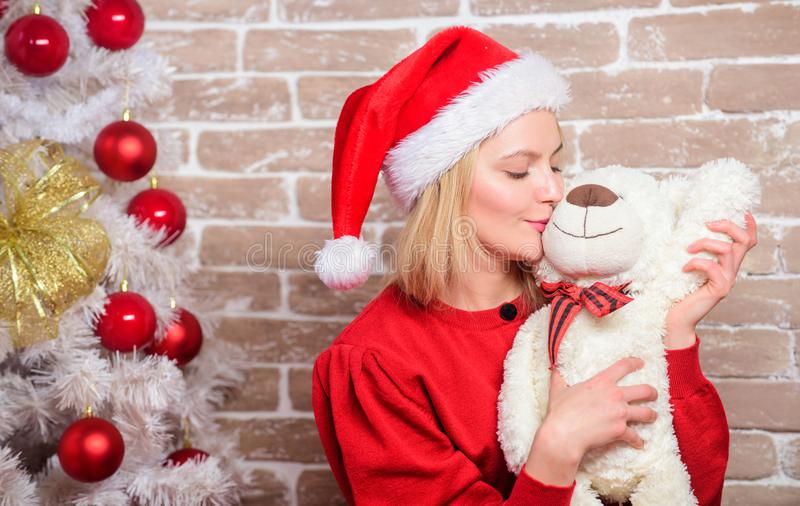 Receive teddy bear as gift. Wish you merry christmas. Top list best gifts for family. Cute and tender gift. Woman santa. Hat hug soft toy bear. Best gift ever stock photography