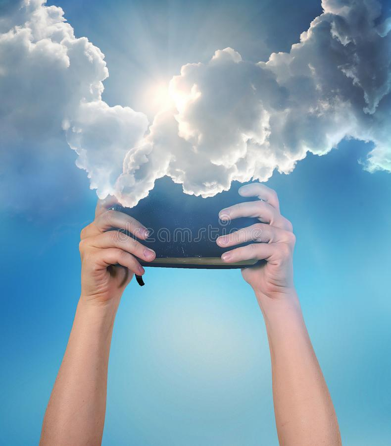 Bible from the heavens. Receiving a Bible from the heavens royalty free stock photography