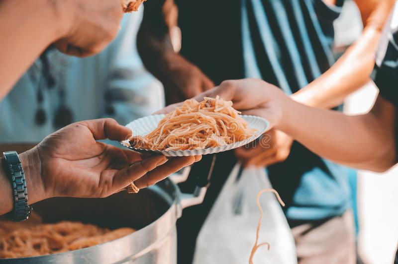 Receiving food for the poor from volunteers: the concept of feeding.  royalty free stock image