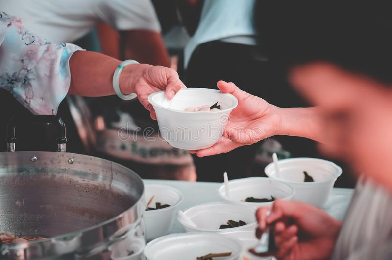 Receiving food for the poor from volunteers: the concept of feeding.  royalty free stock photos