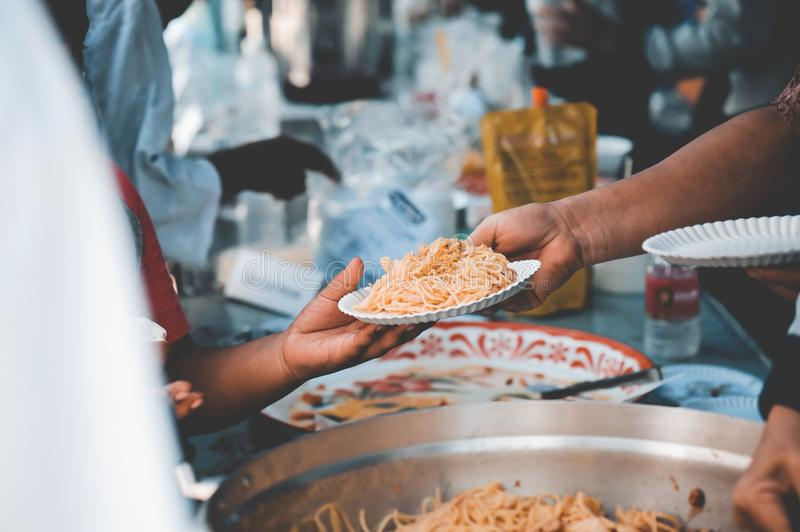 Receiving food for the poor from volunteers: the concept of feeding.  royalty free stock photography
