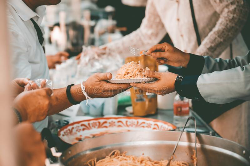 Receiving food for the poor from volunteers: the concept of feeding.  stock photo