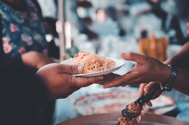Receiving food for the poor from volunteers: the concept of feeding.  stock image