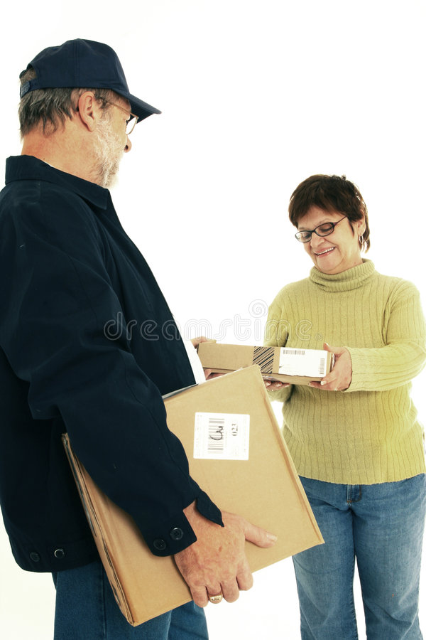 Receiving parcel. Woman receiving parcel by a delivery senior man in navy blue stock photo