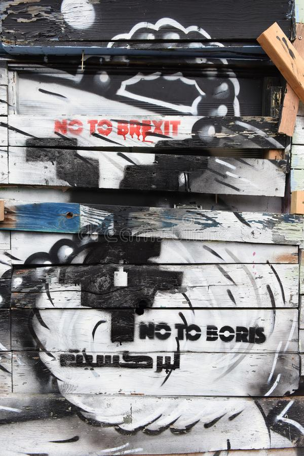 Recent anti political graffiti street art slogans of No to Brexit, No to Boris in London. Close to Brick Lane, London, UK stock images