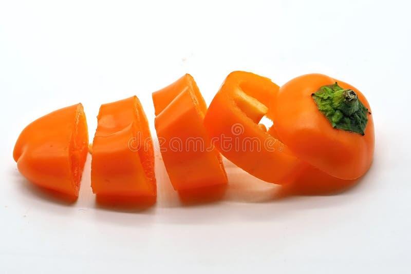 Recentemente fatias do corte de uma pimenta alaranjada doce foto de stock