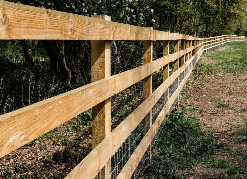 Newly installed fencing seen in a horse paddock. stock photo