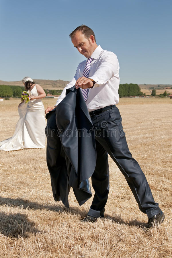 Download Recently Married A Man Fights With His Jacket Stock Photo - Image of wedding, behavior: 25867266