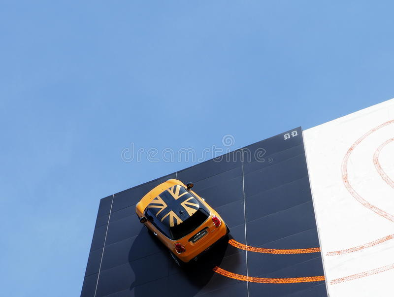 Recently opened BMW Thailand Authorized Dealer. PAKKRED, NONTHABURI, THAILAND - MAY 27, 2015: A Mini Cooper is featured on the facade of recently opened German stock photography