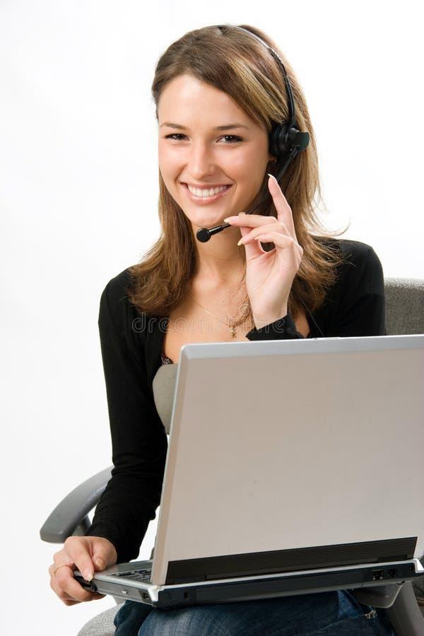 Recepcionista com auriculares imagem de stock