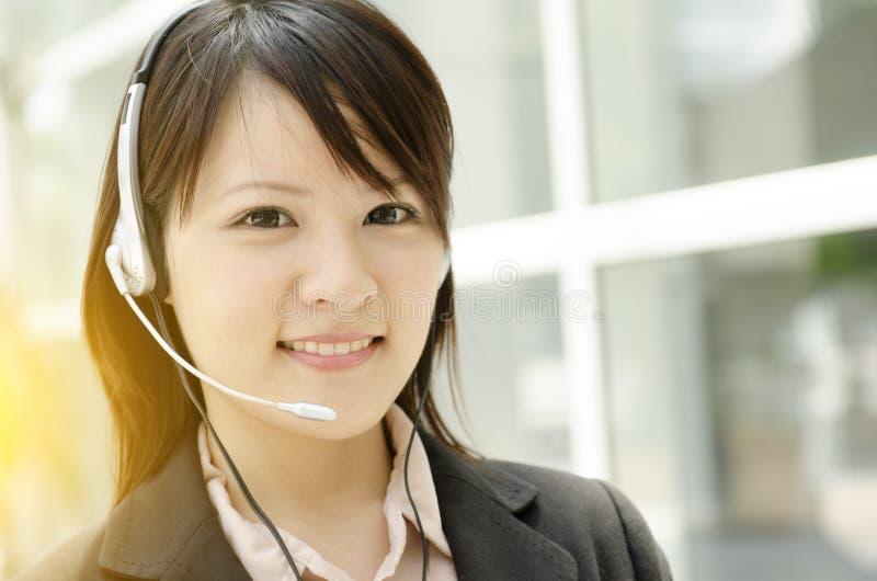 Recepcionista fêmea asiático fotografia de stock