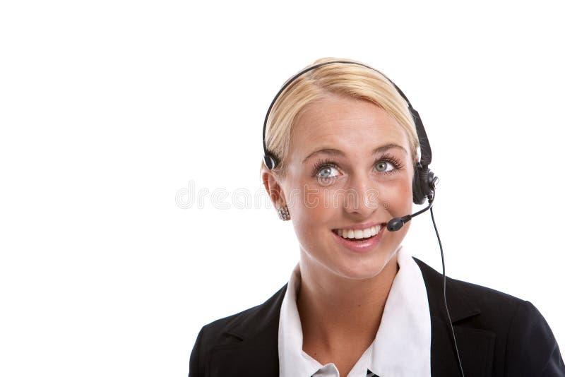 Recepcionista hermoso en el teléfono fotografía de archivo libre de regalías