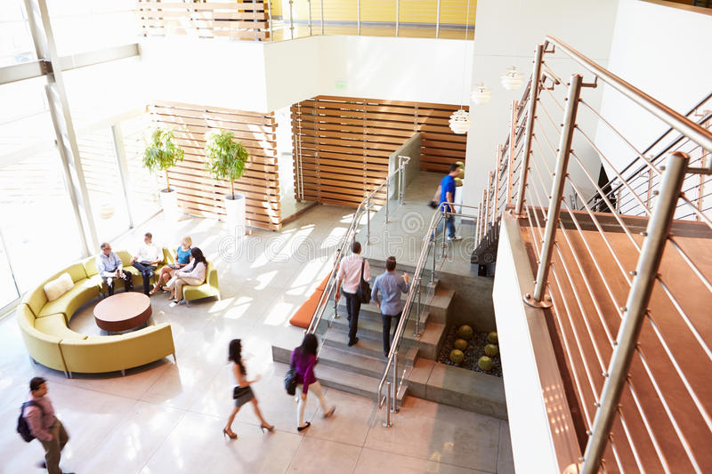 Reception Area Of Modern Office Building With People stock photos