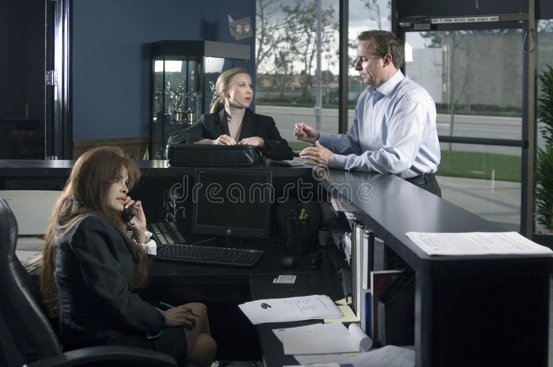 At The Reception Desk Royalty Free Stock Photography