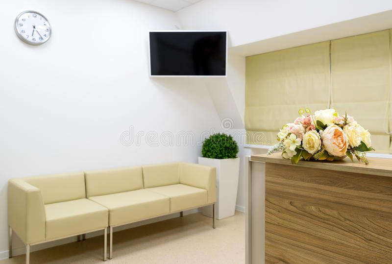 Reception with flower in office. Reception with flower on the blurred clinic or office background stock photography