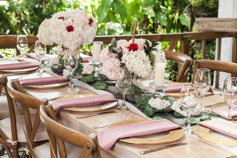 Reception hall decorated with tables for wedding or other social event royalty free stock photo