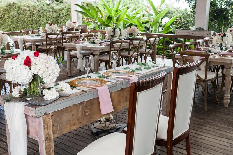 Reception hall decorated with tables for wedding or other social event stock photo