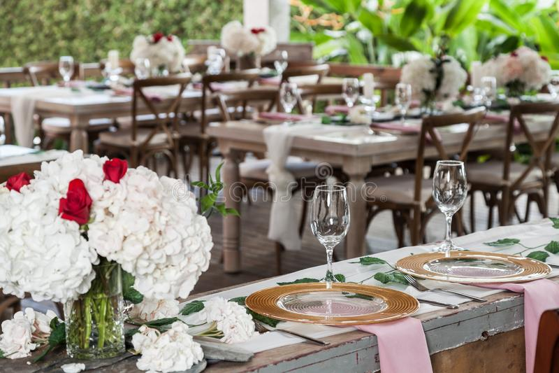 Reception hall decorated with tables for wedding or other social event royalty free stock image