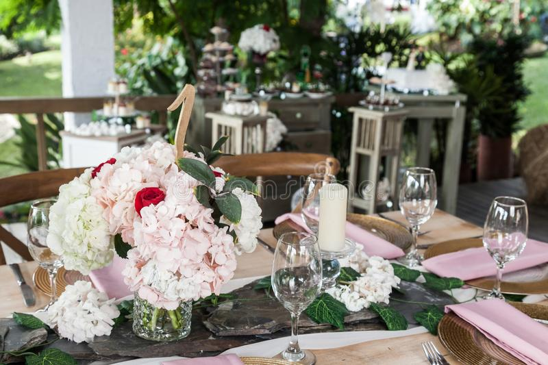 Reception hall decorated with tables for wedding or other social event stock photography